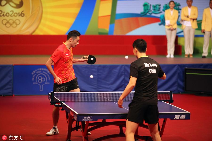 奥运冠军与香港张继玩乒乓球民众科马龙手把楠杨摩托艇俱乐部图片